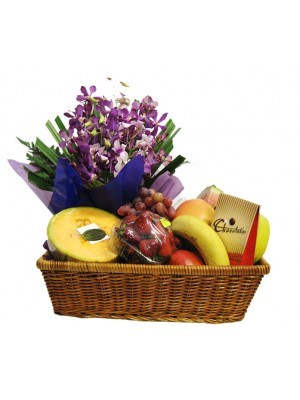 Fruit & Spray of Orchids** delivery included up to a 15km radius